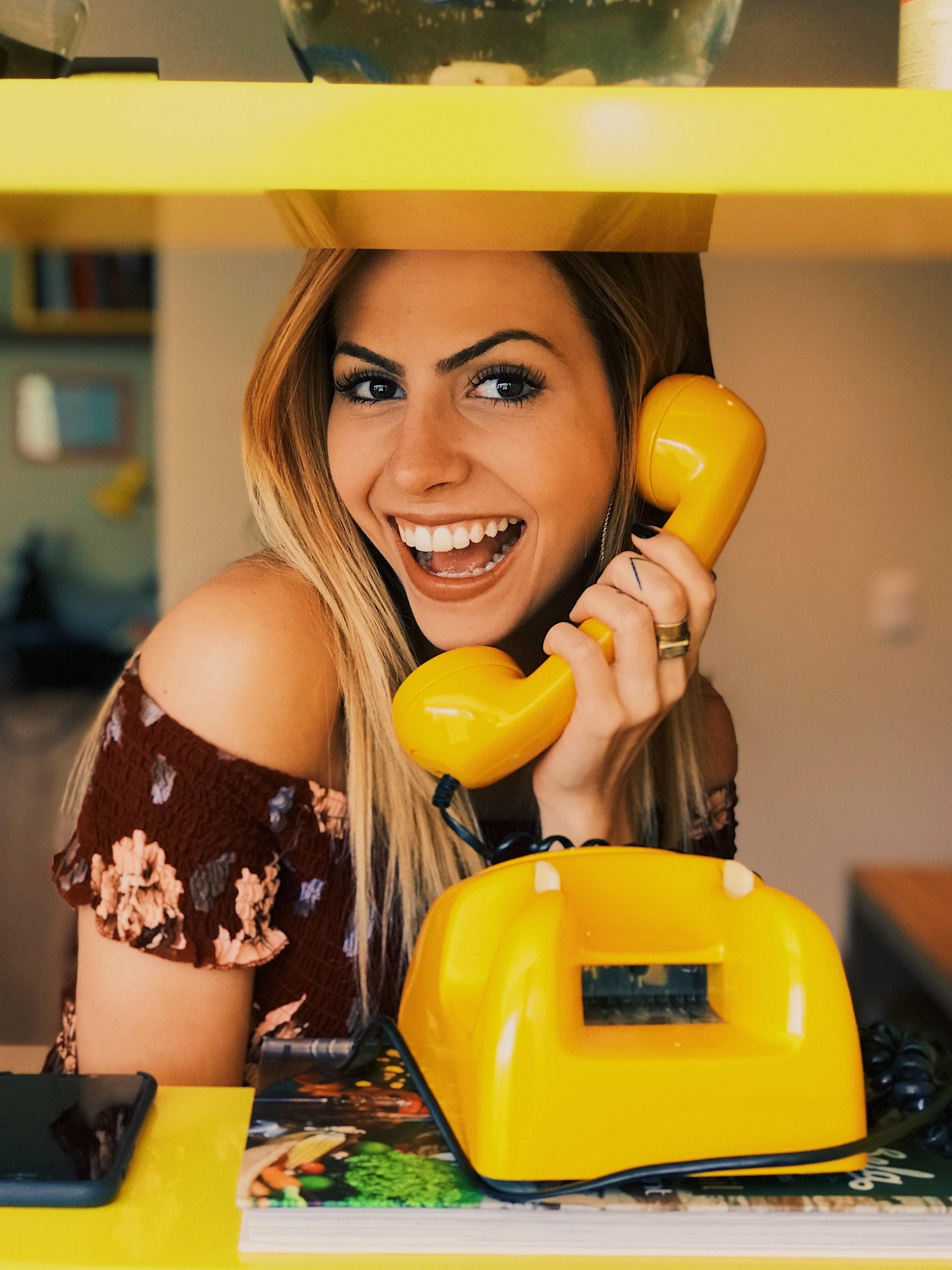 woman-yellow-phone